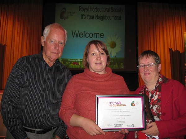 Station Friends and the Community Rail Officer with the North West In Bloom certificate